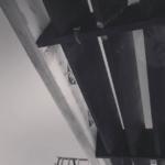 Custom designed steel trellis for second floor balcony over new garage addition in Benedict Canyon