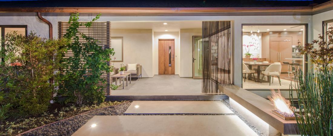 front-courtyard-water-feature-modern-home-sunset-1100x450.jpg