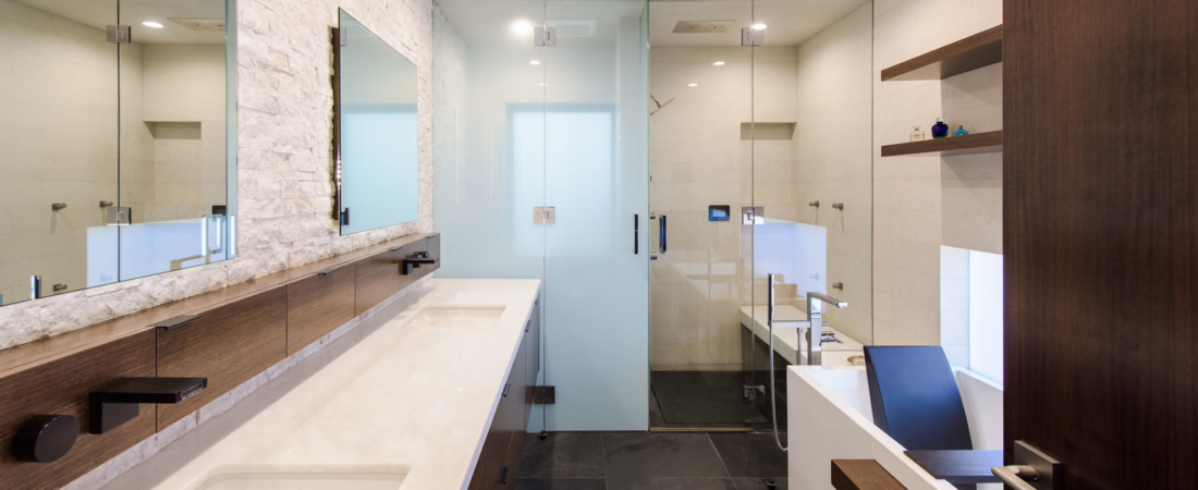 master-bath-floating-vanity-stone-wall-luxury-modern-tub-privacy-water-closet-sunset-1100x450.jpg